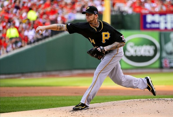 Oct 3, 2013; St. Louis, MO, USA; Pittsburgh Pirates starting pitcher A.J. Burnett throws a pitch against the St. Louis Cardinals in the first inning in game one of the National League divisional series playoff baseball game at Busch Stadium. Mandatory Credit: Scott Rovak-USA TODAY Sports