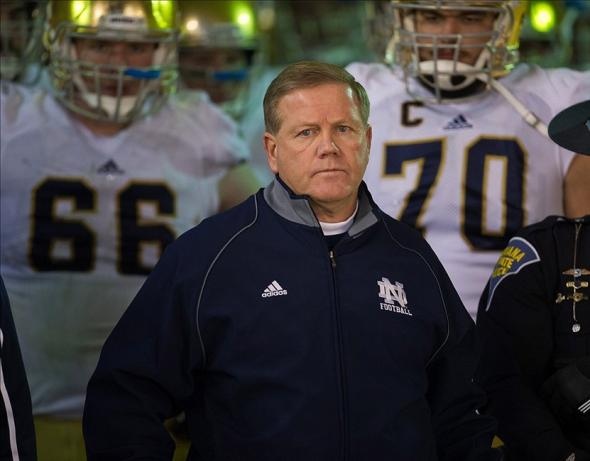 Nov 9, 2013; Pittsburgh, PA, USA; Notre Dame Fighting Irish head coach Brian Kelly prepares to lead his team onto the field for the second half agains the Pittsburgh Panthers at Heinz Field. Pitt won 28-21. Mandatory Credit: Matt Cashore-USA TODAY Sports