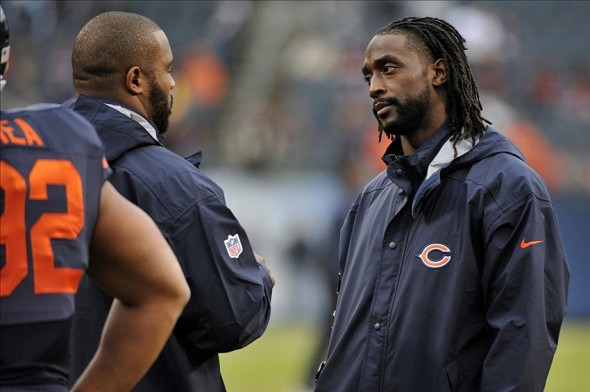 Nov 17, 2013; Chicago, IL, USA; Chicago Bears cinjured ornerback Charles Tillman (right) talks with injured outside linebacker Lance Briggs (left) before the game against the Baltimore Ravens at Soldier Field. Mandatory Credit: Rob Grabowski-USA TODAY Sports