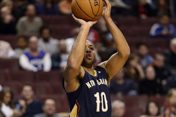 Nov 29, 2013; Philadelphia, PA, USA; New Orleans Pelicans guard Eric Gordon (10) shoots a jump shot during the fourth quarter against the Philadelphia 76ers at the Wells Fargo Center. The Pelicans defeated the Sixers 121-105. Mandatory Credit: Howard Smith-USA TODAY Sports