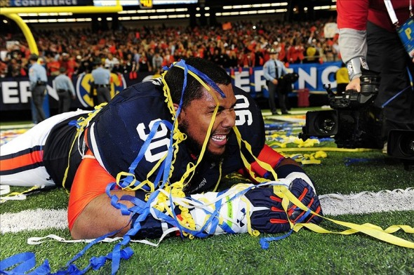 Dec 7, 2013; Atlanta, GA, USA; Auburn Tigers defensive lineman Gabe Wright (90) celebrates after the 2013 SEC Championship game against the Missouri Tigers at Georgia Dome. The Auburn Tigers defeated the Missouri Tigers 59-42. Mandatory Credit: Kevin Liles-USA TODAY Sports