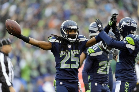 Dec 22, 2013; Seattle, WA, USA; Seattle Seahawks cornerback Richard Sherman (25) celebrates during the first half after intercepting a pass thrown by Arizona Cardinals quarterback Carson Palmer (3) (not pictured) at CenturyLink Field. Mandatory Credit: Steven Bisig-USA TODAY Sports