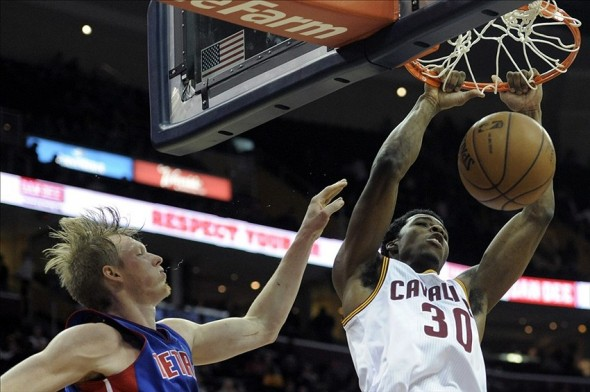Dec 23, 2013; Cleveland, OH, USA; Cleveland Cavaliers shooting guard Carrick Felix (30) dunks against Detroit Pistons small forward Kyle Singler in the fourth quarter at Quicken Loans Arena. Mandatory Credit: David Richard-USA TODAY Sports