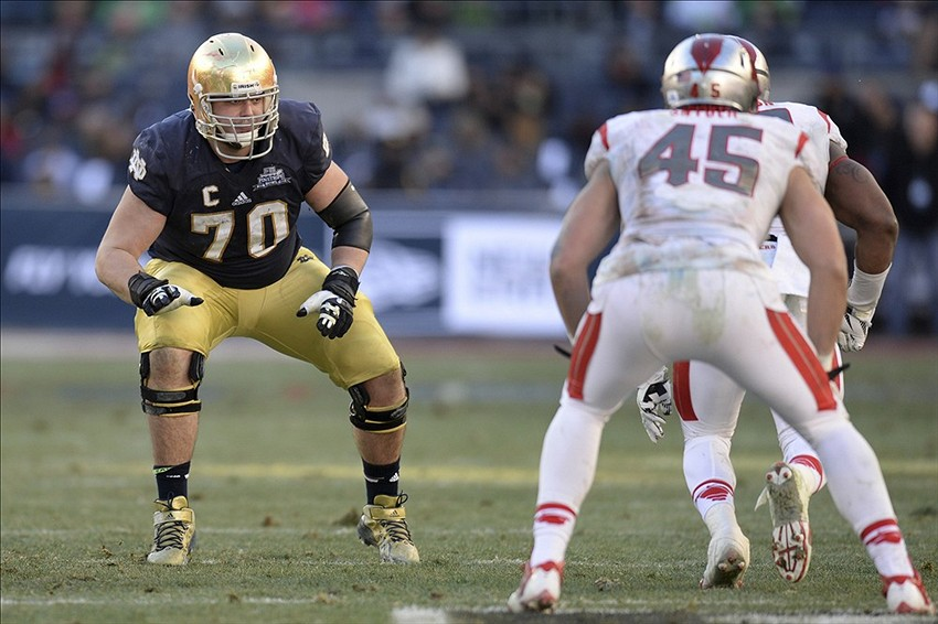 Dec 28, 2013; Bronx, NY, USA; Notre Dame Fighting Irish offensive tackle Zack Martin (70) blocks against the Rutgers Scarlet Knights during the second half of the Pinstripe Bowl at Yankees Stadium. Notre Dame Fighting Irish won the game 29-16. Mandatory Credit: Joe Camporeale-USA TODAY Sports