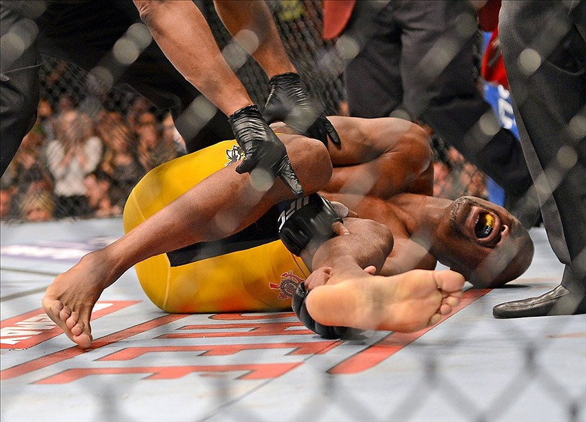 Dec 28, 2013; Las Vegas, NV, USA; Anderson Silva reacts after breaking his leg on a kick to Chris Weidman (not pictured) during their UFC middleweight championship bout at the MGM Grand Garden Arena. Mandatory Credit: Jayne Kamin-Oncea-USA TODAY Sports