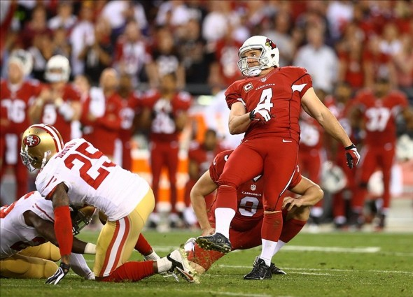 Dec 29, 2013; Phoenix, AZ, USA; Arizona Cardinals kicker Jay Feely (4) kicks a field goal in the fourth quarter against the San Francisco 49ers at University of Phoenix Stadium. The 49ers defeated the Cardinals 23-20. Mandatory Credit: Mark J. Rebilas-USA TODAY Sports