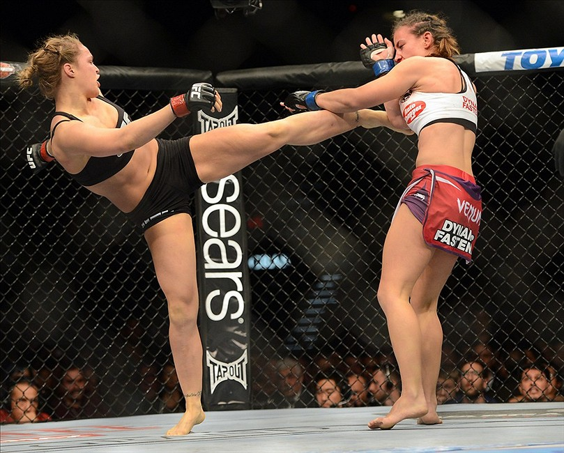 Dec 28, 2013; Las Vegas, NV, USA; Ronda Rousey (red gloves) and Miesha Tate (blue gloves) during their UFC Women's Bantamweight Championship Bout at the MGM Grand Garden Arena. Ronda Rousey won Mandatory Credit: Jayne Kamin-Oncea-USA TODAY Sports