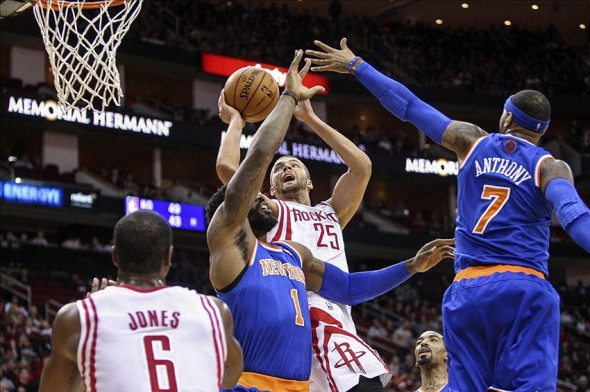 Jan 3, 2014; Houston, TX, USA; Houston Rockets small forward Chandler Parsons (25) drives to the basket during the first quarter as New York Knicks power forward Amar
