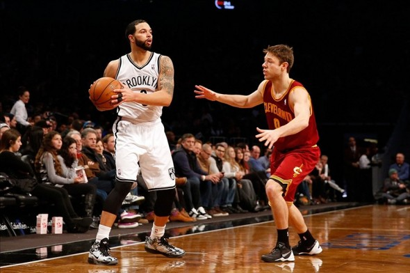 Jan 4, 2014; Brooklyn, NY, USA; Brooklyn Nets point guard Deron Williams (8) controls the ball in front of Cleveland Cavaliers shooting guard Matthew Dellavedova (9) during the third quarter at Barclays Center. Brooklyn Nets won 89-82. Mandatory Credit: Anthony Gruppuso-USA TODAY Sports