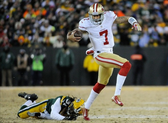 Jan 5, 2014; Green Bay, WI, USA; San Francisco 49ers quarterback Colin Kaepernick (7) runs with the ball past Green Bay Packers cornerback Davon House (31) in the second quarter during the 2013 NFC wild card playoff football game at Lambeau Field. Mandatory Credit: Benny Sieu-USA TODAY Sports