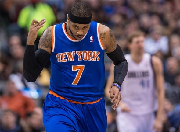 Jan 5, 2014; Dallas, TX, USA; New York Knicks small forward Carmelo Anthony (7) celebrates making a three point against the Dallas Mavericks during the first half at the American Airlines Center. Mandatory Credit: Jerome Miron-USA TODAY Sports