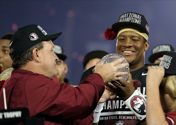 Jan 6, 2014; Pasadena, CA, USA; Florida State Seminoles head coach Jimbo Fisher celebrates as he hands the trophy to Jameis Winston (right) after defeating the Auburn Tigers 34-31 the 2014 BCS National Championship game at the Rose Bowl. Mandatory Credit: Matthew Emmons-USA TODAY Sports