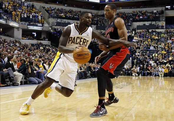 Jan 7, 2014; Indianapolis, IN, USA; Indiana Pacers guard Lance Stephenson (1) drives to the basket against Toronto Raptors guard DeMar DeRozan (10) at Bankers Life Fieldhouse. Indiana defeats Toronto 86-79. Mandatory Credit: Brian Spurlock-USA TODAY Sports