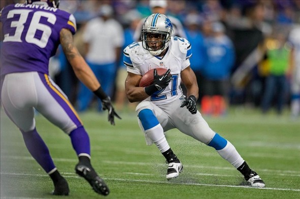 Dec 29, 2013; Minneapolis, MN, USA; Detroit Lions running back Reggie Bush (21) rushes against the Minnesota Vikings in the third quarter at Mall of America Field at H.H.H. Metrodome. The Vikings win 14-13. Mandatory Credit: Bruce Kluckhohn-USA TODAY Sports