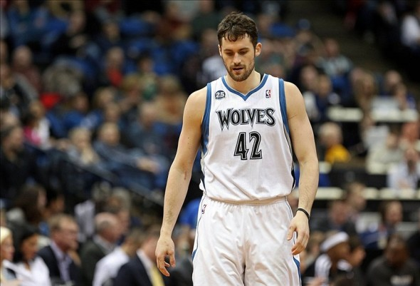 Jan 18, 2014; Minneapolis, MN, USA; Minnesota Timberwolves power forward Kevin Love (42) looks on in the second half against the Utah Jazz at Target Center. The Timberwolves won 98-72. Mandatory Credit: Jesse Johnson-USA TODAY Sports