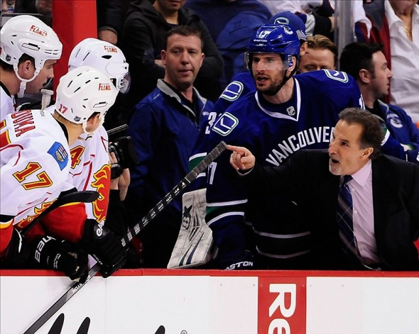Jan 18, 2014; Vancouver, British Columbia, CAN; Vancouver Canucks head coach John Tortorella and forward Ryan Kesler (17) talk to the Calgary Flames defenseman Shane O