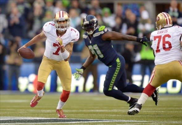 Jan 19, 2014; Seattle, WA, USA; San Francisco 49ers quarterback Colin Kaepernick (7) scrambles with the ball against the Seattle Seahawks during the first half of the 2013 NFC Championship football game at CenturyLink Field. Mandatory Credit: Kirby Lee-USA TODAY Sports