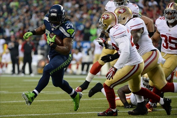 Jan 19, 2014; Seattle, WA, USA; Seattle Seahawks running back Marshawn Lynch (24) runs the football against San Francisco 49ers cornerback Carlos Rogers (22) during the first half of the 2013 NFC Championship football game at CenturyLink Field. Mandatory Credit: Kyle Terada-USA TODAY Sports