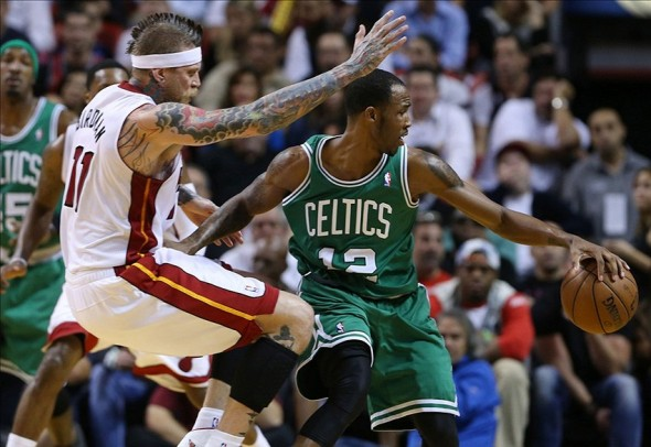 Jan 21, 2014; Miami, FL, USA; Miami Heat power forward Chris Andersen (11) defends Boston Celtics small forward Chris Johnson (12) in the second half at American Airlines Arena. The Heat won 93-86. Mandatory Credit: Robert Mayer-USA TODAY Sports