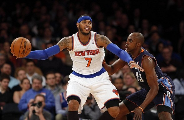 Jan 24, 2014; New York, NY, USA; Charlotte Bobcats power forward Anthony Tolliver (43) defends against New York Knicks small forward Carmelo Anthony (7) in the first half at Madison Square Garden. Mandatory Credit: Noah K. Murray-USA TODAY Sports