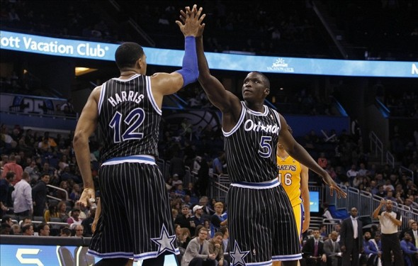 Jan 24, 2014; Orlando, FL, USA; Orlando Magic small forward Tobias Harris (12) and shooting guard Victor Oladipo (5) high five against the Los Angeles Lakers during the second half at Amway Center. Orlando Magic won 114-105. Mandatory Credit: Kim Klement-USA TODAY Sports