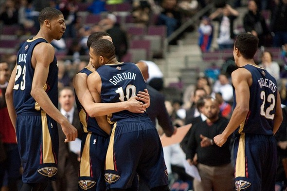 Jan 24, 2014; Auburn Hills, MI, USA; New Orleans Pelicans shooting guard Eric Gordon (10) celebrates with teammates after making the game winning shot against the Detroit Pistons at The Palace of Auburn Hills. New Orleans won 103-101. Mandatory Credit: Tim Fuller-USA TODAY Sports