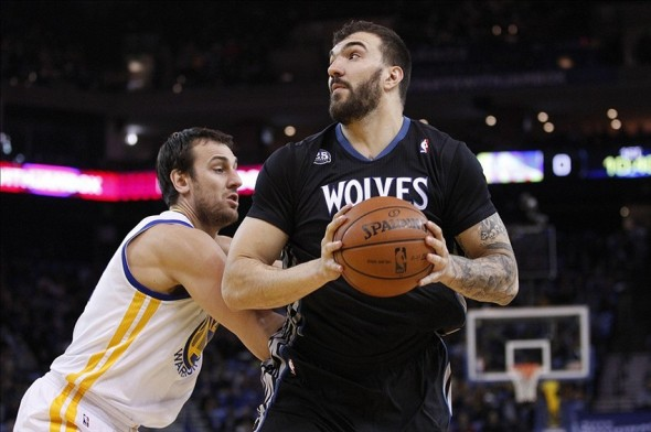 Jan 24, 2014; Oakland, CA, USA; Minnesota Timberwolves center Nikola Pekovic (14) spins towards the hoop against the Golden State Warriors in the first quarter at Oracle Arena. Mandatory Credit: Cary Edmondson-USA TODAY Sports