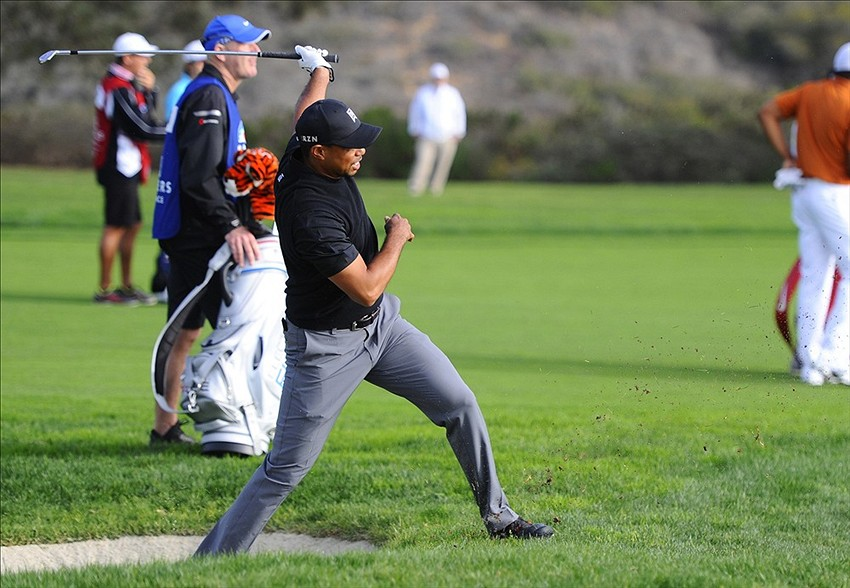 Jan 25, 2014; La Jolla, CA, USA; Tiger Woods hits the ball off the edge of a bunker on the thirteenth hole during the third round of the Farmers Insurance Open golf tournament at Torrey Pines Municipal Golf Course - South Co. Mandatory Credit: Christopher Hanewinckel-USA TODAY Sports