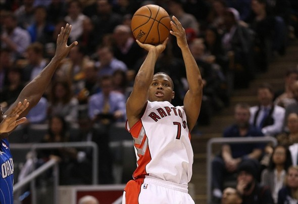 Jan 29, 2014; Toronto, Ontario, CAN; Toronto Raptors point guard Kyle Lowry (7) shoots against the Orlando Magic at Air Canada Centre. The Raptors beat the Magic 98-83. Mandatory Credit: Tom Szczerbowski-USA TODAY Sports