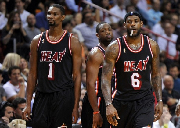 Jan 29, 2014; Miami, FL, USA; Miami Heat center Chris Bosh (left) shooting guard Dwyane Wade (center) and small forward LeBron James (right) react after a timeout after the Oklahoma City Thunder during the second half at American Airlines Arena. Mandatory Credit: Steve Mitchell-USA TODAY Sports