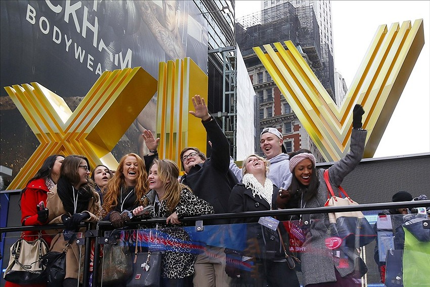 Jan 31, 2014; New York, NY, USA; Fans pose for photos on Super Bowl Boulevard in Time Square on Broadway in advance of Super Bowl XLVIII. Mandatory Credit: Adam Hunger-USA TODAY Sports