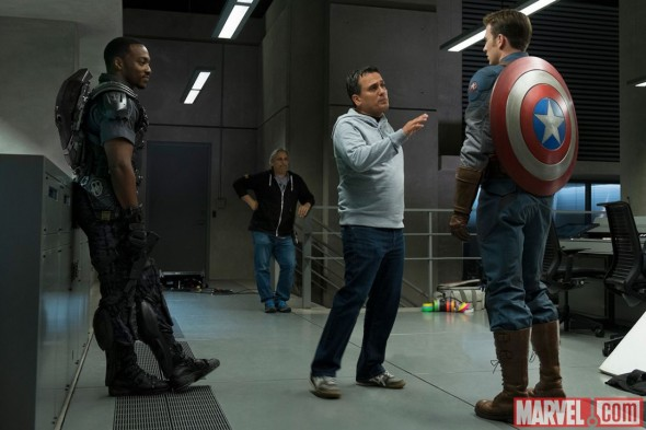 "Anthony Mackie and Chris Evans as Falcon and Captai America along with Director Joe Russo on the set of ""Captain America: The Winter Soldier."" Photo Credit: Marvel"