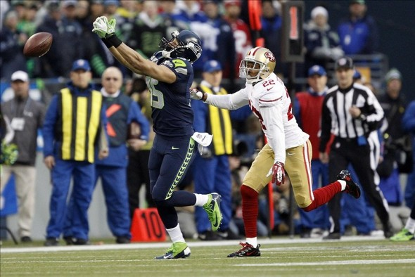 Jan 19, 2014; Seattle, WA, USA; Seattle Seahawks wide receiver Jermaine Kearse (15) is unable to catch a pass while defended by San Francisco 49ers cornerback Carlos Rogers (22) during the first half of the 2013 NFC Championship football game at CenturyLink Field. Mandatory Credit: Joe Nicholson-USA TODAY Sports