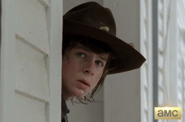 "Chandler Riggs as Carl Grimes in the Midseason Premiere of ""The Walking Dead."" Photo Credit: AMC"