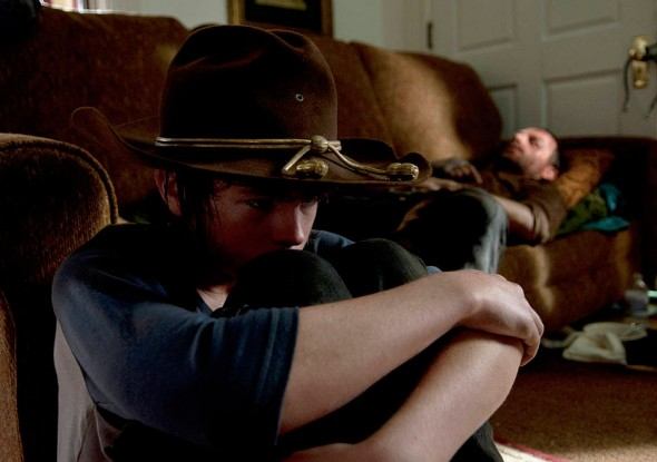 "Chandler Riggs and Andrew Lincoln as Carl and Rick Grimes in Season 4, Episode 9 of ""The Walking Dead."" Photo Credit: Gene Page/AMC"
