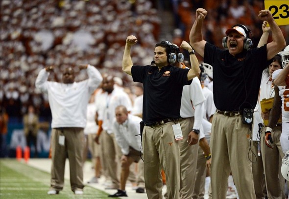 Dec 29, 2012; San Antonio, TX, USA; Texas Longhorns defensive coordinator Manny Diaz (center) signals a play against the Oregon State Beavers during the second half of the Alamo Bowl at the Alamodome. Texas beat Oregon State 31-27. Mandatory Credit: Brendan Maloney-USA TODAY Sports