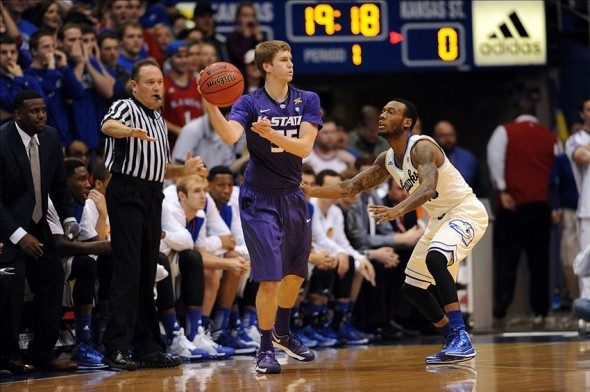 Jan 11, 2014; Lawrence, KS, USA; Kansas State Wildcats guard Will Spradling (55) passes the ball as Kansas Jayhawks guard Naadir Tharpe (10) defends during the first half at Allen Fieldhouse. Mandatory Credit: Denny Medley-USA TODAY Sports