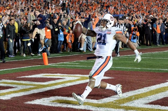 Jan 6, 2014; Pasadena, CA, USA; Auburn Tigers running back Tre Mason (21) scores a touchdown against the Florida State Seminoles during the second half of the 2014 BCS National Championship game at the Rose Bowl. Mandatory Credit: Jayne Kamin-Oncea-USA TODAY Sports