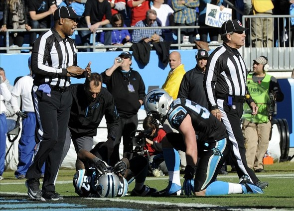 Jan 12, 2014; Charlotte, NC, USA; Carolina Panthers strong safety Quintin Mikell (27) is tended to after an apparent injury during the second quarter of the 2013 NFC divisional playoff football game against the San Francisco 49ers at Bank of America Stadium. Mandatory Credit: Sam Sharpe-USA TODAY Sports