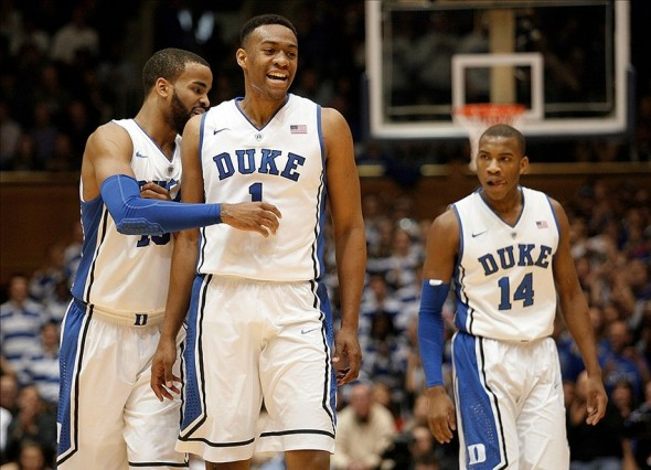 Jan 18, 2014; Durham, NC, USA; Duke Blue Devils forward Jabari Parker (1) and forward Josh Hairston (15) and guard Rasheed Sulaimon (14) head to the bench for a timeout against the North Carolina State Wolfpack at Cameron Indoor Stadium. Mandatory Credit: Mark Dolejs-USA TODAY Sports
