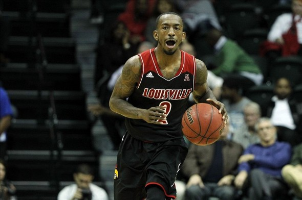 Jan 22, 2014; Tampa, FL, USA; Louisville Cardinals guard Russ Smith (2) drives to the basket as he calls a play against the South Florida Bulls during the second half at USF Sun Dome. Louisville Cardinals defeated the South Florida Bulls 86-47. Mandatory Credit: Kim Klement-USA TODAY Sports
