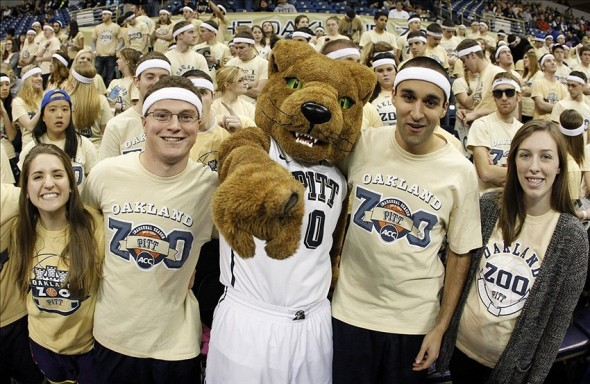Jan 21, 2014; Pittsburgh, PA, USA; The Pittsburgh Panthers mascot and students pose prior to the game against the Clemson Tigers at the Petersen Events Center. Mandatory Credit: Charles LeClaire-USA TODAY Sports