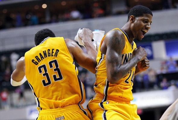 April 03, 2012; Indianapolis, IN, USA; Indiana Pacers small forward Danny Granger (33) and shooting guard Paul George (24) celebrate during the game against the New York Knicks at Bankers Life Fieldhouse. Indiana defeated New York 112-104. Mandatory credit: Michael Hickey-USA TODAY Sports