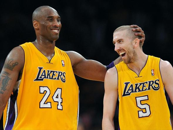 May 12, 2012; Los Angeles, CA, USA; Los Angeles Lakers shooting guard Kobe Bryant (24) and and point guard Steve Blake (5) react in the final seconds of game seven of the Western Conference quarterfinals of the 2012 NBA Playoffs against the Denver Nuggets at the Staples Center. Lakers won 96-87. Mandatory Credit: Jayne Kamin-Oncea-USA TODAY Sports