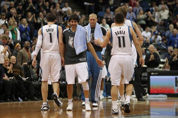 Dec 15, 2012; Minneapolis, MN, USA; Minnesota Timberwolves guard Ricky Rubio (second from left) congratulates guard Alexey Shved (1) and Jose Juan Barea (11) against the Dallas Mavericks at the Target Center. The Wolves defeated the Mavericks 114-106 in overtime. Mandatory Credit: Brace Hemmelgarn-USA TODAY Sports