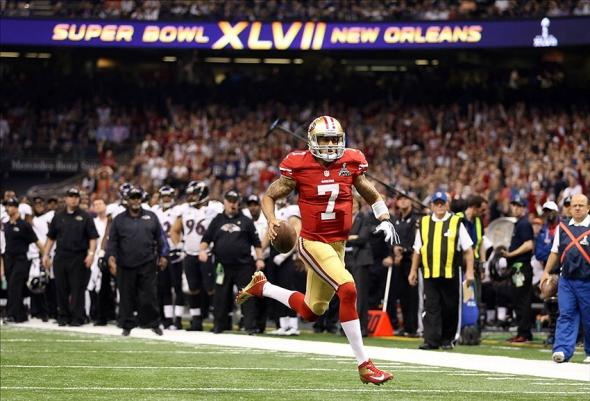 Feb 3, 2013; New Orleans, LA, USA; San Francisco 49ers quarterback Colin Kaepernick (7) scores a touchdown against the Baltimore Ravens in the fourth quarter in Super Bowl XLVII at the Mercedes-Benz Superdome. Mandatory Credit: Mark J. Rebilas-USA TODAY Sports