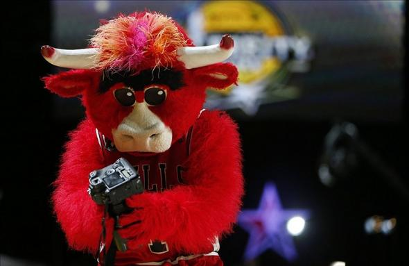 Feb 15, 2013; Houston, TX, USA; Chicago Bulls mascot Benny holds a photographer's camera during the 2013 NBA All-Star Weekend Celebrity Game. Property USA Today Sports