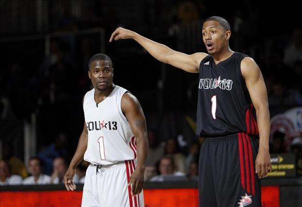 Feb 15, 2013; Houston, TX, USA; Television and radio personality Nick Cannon (right) points at comedian Kevin Hart (left) during the 2013 NBA all star celebrity game at the George R. Brown Convention Center. Mandatory Credit: Brett Davis-USA TODAY Sports