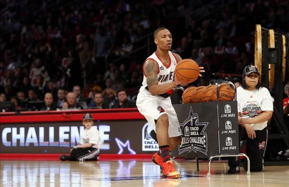 Feb 16, 2013; Houston, TX, USA; Portland Trailblazers guard Damian Laillard (0) during the 2013 NBA all star skills challenge at the Toyota Center. Mandatory Credit: Brett Davis-USA TODAY Sports