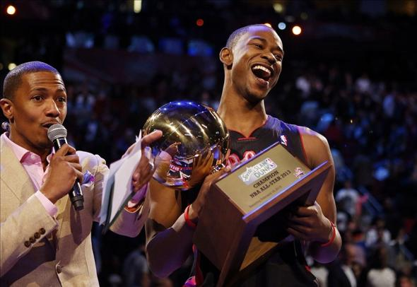 Feb 16, 2013; Houston, TX, USA; Toronto Raptors guard Terrence Ross (right) reacts after receiving the slam dunk contest trophy from television/radio personality Nick Cannon during the 2013 NBA all star slam dunk contest at the Toyota Center. Mandatory Credit: Brett Davis-USA TODAY Sports